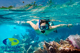 Woman snorkeling near coral in Isla Mujeres – Best Places In The World To Retire – International Living