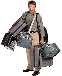 Man holding suitcases – Best Places In The World To Retire – International Living