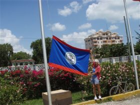 Woman holding Belize flag – Best Places In The World To Retire – International Living