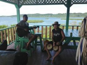 expats playing instruments at Los Secretos, Bocas Del Toro, Panama – Best Places In The World To Retire – International Living