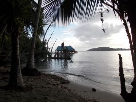 Bocas Del Toro sunset, water, and palm trees – Best Places In The World To Retire – International Living