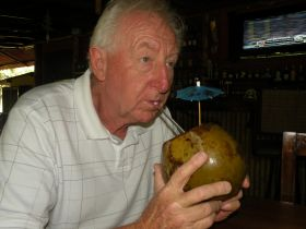 Enjoying a coconut rum at Amigos in Boquete, Panama – Best Places In The World To Retire – International Living