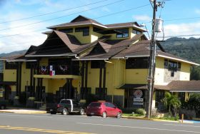 Yellow house on the road in Boquete, Panama – Best Places In The World To Retire – International Living