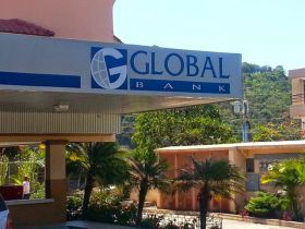 Global Bank in Panama, view of sign and background of building – Best Places In The World To Retire – International Living