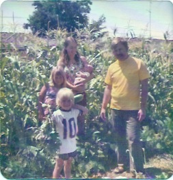 David and Tuey Murdock with young family in the garden – Best Places In The World To Retire – International Living